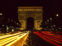 Arc de Triomphe and Champs Elysees night. Traffic trails on the Champs Elysees with Arc de Triomphe beyond Stock Image