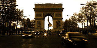 Arc de Triomphe on the Champs Elysees in Paris France with speed Stock Photos
