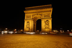 Arc de Triomphe on Charles de Gaulle square. Arc de Triomphe on the Charles de Gaulle square at night Stock Images