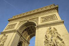 Arc de Triomphe in a clear day. Arc de Triomphe at sunset in Paris, France Stock Photos