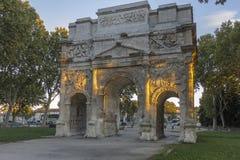 Arc de triomphe d'Orange in evening sunlight. The Triumphal Arch of Orange is a triumphal arch located in the town of Orange, southeast France Stock Image