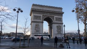Arc de triomphe de l`Étoile. A view of the Arc de Triomphe de l`Étoile during the sunset in the winter time where we can see the busy street Royalty Free Stock Photography
