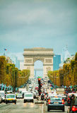 Arc de Triomphe de l'Etoile in Paris. PARIS - OCTOBER 13: The Arc de Triomphe de l'Etoile on October 13, 2014 in Paris, France. It's one of the most famous Stock Photography