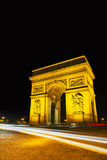 Arc de Triomphe de l'Etoile in Paris. Arc de Triomphe de l'Etoile (The Triumphal Arch) in Paris at night Royalty Free Stock Photography