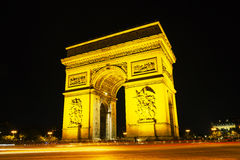 Arc de Triomphe de l'Etoile in Paris. Arc de Triomphe de l'Etoile (The Triumphal Arch) in Paris at night Royalty Free Stock Images