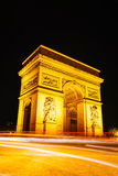 Arc de Triomphe de l'Etoile in Paris. Arc de Triomphe de l'Etoile (The Triumphal Arch) in Paris at night Stock Photo