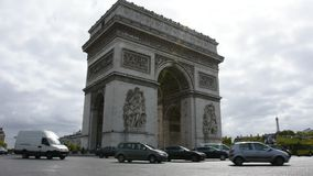 Arc de triomphe de l`Etoile or Triumphal Arch of the Star at Place Charles de Gaulle in Paris, France. Paris, France - September 6: French people and foreigner stock video footage