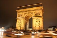 Arc de Triomphe de Paris na noite Fotografia de Stock
