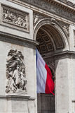Arc de Triomphe detail showing the french flag. Arc de Triomphe detail showing french flag flying from underneath Royalty Free Stock Images