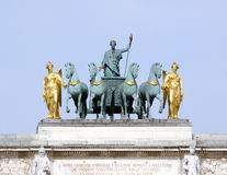 Arc de triomphe du carrousel. Quadriga on top of the Arc de triomphe du carrousel in Paris royalty free stock photo