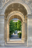 Through Arc de Triomphe du Carrousel. View through Arc de Triomphe du Carrousel, a triumphal arch in Paris, France Royalty Free Stock Photography