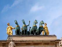 Arc de Triomphe du Carrousel. Detail in the upper part the Arc de Triomphe Karruzel Paris. Arch surmounted by a chariot drawn by four Corinthian style horses Royalty Free Stock Photos