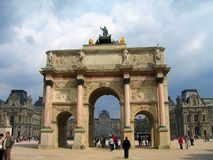 Arc de Triomphe du Carrousel between the Louvre and the Tuileries in Paris, France royalty free stock photo