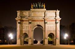Arc de Triomphe du Carrousel at night. Illuminated Arc de Triomphe du Carrousel at night, Paris, France Stock Photos