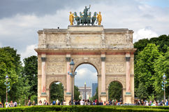 Arc de Triomphe du Carrousel. Paris, France. PARIS - JUNE 06: Famous Triumphal Arch (aka Arc de Triomphe du Carrousel) in Tuileries gardens. The monument was Royalty Free Stock Photo