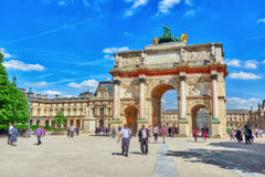 Arc de Triomphe du Carrousel. PARIS, FRANCE - JULY 06, 2016 : Arc de Triomphe du Carrousel 1806-1808 and people around, designed by Charles Percier near Louvre Royalty Free Stock Images
