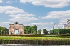 Arc de Triomphe du Carrousel, Paris. View of Arc de Triomphe du Carrousel and  Tuileries Garden at sunny day, Paris, France Stock Image