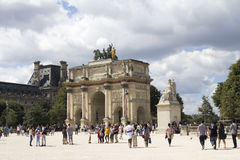 Arc de Triomphe du Carrousel. 1806-1808 and people around, designed by Charles Percier near Louvre, Paris, France Stock Images