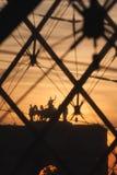 Arc de Triomphe du Carrousel at sunset. The Louvre glass pyramid and Arc de Triomphe du Carrousel at sunset. Paris. France Stock Photos