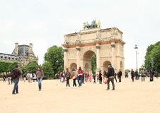 Arc de Triomphe du Carrousel. Tourists around Arc de Triomphe du Carrousel near by Louvre Museum in Paris (France Stock Photos