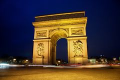 Arc de Triomphe in the evening. A view at the Arc the Triomphe in Paris in the evening. With passing cars Stock Photo