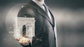 Arc de Triomphe France Businessman Holding in Hand Landmark New technologies. Businessman in the future with futuristic technology with landmark Royalty Free Stock Photo
