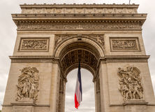 Arc de Triomphe with french flag. Hanging limp below Royalty Free Stock Image