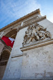 Detail of Arc de Triomphe with French Flag Royalty Free Stock Photo