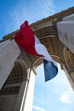 Waving French Flag at Arc de Triomphe Royalty Free Stock Photography