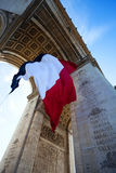 Detail of Waving French Flag at Arc de Triomphe Stock Photography