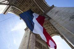 Arc de Triomphe with French Flag Stock Photo