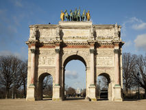 Arc de Triomphe. In front of the Tuileries park. View from the Louvre Museum. the image on background blue sky Royalty Free Stock Photography