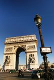 Arc de triomphe front view. Arc de triomphe from a front view at place charles de gaulle, Paris, France, with smart passing by Royalty Free Stock Photo