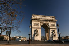 Arc de triomphe front view. Arc de triomphe from a front view at place charles de gaulle, Paris, France, with smart passing by Royalty Free Stock Images