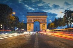 Arc de Triomphe. Image of the iconic Arc de Triomphe in Paris city during twilight blue hour Stock Images