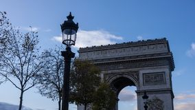 Arc de triomphe de l`Étoile. A low view of the Arc de Triomphe de l`Étoile here we see as well one of the classic old street lamps Stock Photography