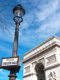 Arc de Triophe Etoile & Street sign Paris France. The Arc de Triomphe de l`Etoile and a street lamp post with the sign Place Charles de Gaulle. Sunlight Stock Image