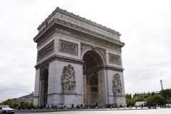 Arc de triomphe de l`Etoile or Triumphal Arch of the Star at Place Charles de Gaulle in Paris, France. French people and foreigner travlers walk visit Arc de Stock Photo