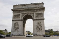 Arc de triomphe de l`Etoile or Triumphal Arch of the Star at Place Charles de Gaulle in Paris, France. French people and foreigner travlers walk visit Arc de Stock Image