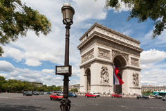 Arc de Triomphe with lamppost in foreground. Showing the full roundabout Royalty Free Stock Photography