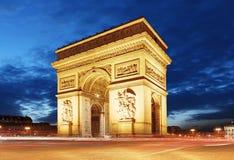Arc De Triomphe and light trails, Paris.  Royalty Free Stock Images