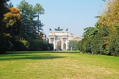 The Arc de Triomphe in Milan. Central Park in Milan. A trimmed lawn in the park around the Arc de Triomphe Royalty Free Stock Photography