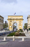 Arc de Triomphe in Montpellier, dating from 1692, with surroun. MONTPELLIER, FRANCE - MAR 31, 2017: Arc de Triumphe in Montpellier, dating from 1692, with Stock Photography