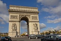 Arc de Triomphe monument, Paris. Arc de Triomphe monument on a busy square with lots of cars and tourists, Paris, France Royalty Free Stock Photos