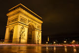 The Arc de Triomphe at Night. Light trails surround Paris's Arc de Triomphe at Night Royalty Free Stock Images