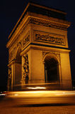 Arc de Triomphe at Night. A car in motion in front of Arc de Triomphe at night Royalty Free Stock Image