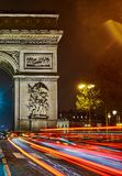 Arc de Triomphe at night. Colorful night in Paris. Cars are comming from The Avenue des Champs-Élysées. Crossroads in front of the Arc de Triomphe Royalty Free Stock Photos