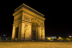 The Arc de Triomphe by night. Located in Paris, France, the Arc de Triomphe is located at the top of the Champs-Elysees Stock Photography