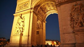 Arc de Triomphe night. Panorama of tourists under Arch of triumph at night in Paris, France. Arc de Triomphe at the western end of the Champs Elysees and at the stock video