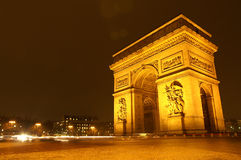 Arc De Triomphe at night in Paris, France Stock Photography